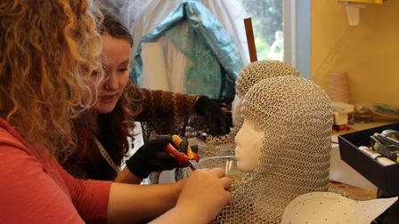 Wardrobe team Ruth Metcalf and Jess Fisher working on chain mail helemts for Spamalot. Picture: CONT