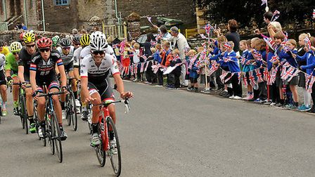 School children cheer on riders during a previous Tour of Britain Race. picture:TOUR OF BRITAIN