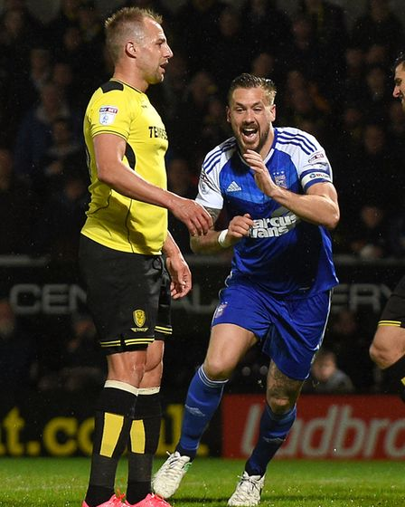 Luke Chambers inexplicably celebrates Luke Varney's own goal at Burton as though it was his own