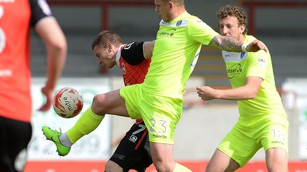 Sean Murray pressures Morecambe's Paul Mullin during this afternoon's 1-1 draw at the Globe Arena. P