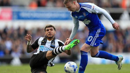 Newcastle United's DeAndre Yedlin and Ipswich Town's Freddie Sears battle for the ball during the Sk