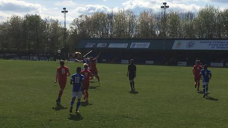 Action from this afternoon's Ryman Premier clash between Tonbridge Angels and AFC Sudbury (red shirt