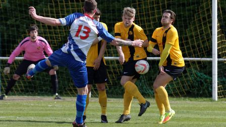 FC Clacton skipper Kevin Coyle fires a free-kick straight at the Mildenhall wall. Photos: PAUL VOLLE
