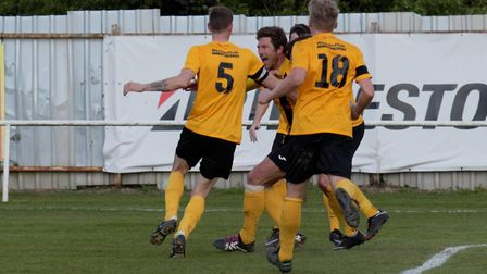 Chris Bacon celebrates with team-mates after putting Mildenhall ahead in the final minutes on Saturd
