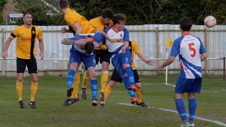 Chris Bacon (centre) heads the only goal of the game in the 89th minute as Mildenhall beat FC Clacto