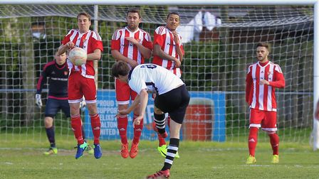 GOAL Luke Haines strikes his free kick to equalise for Haverhill at Felixstowe on Saturday. Photos: