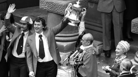 Sir Bobby Robson lifting the FA Cup with the Mayor of Ipswich in the town after winning it in 1978.