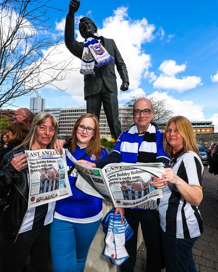 Town fans Emily and Adrian Croucher (centre) with Newcastle fans Angie Buak (left) and Lesley Wright