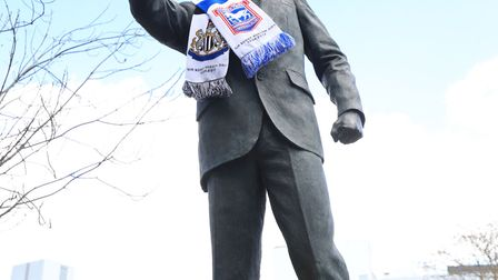The statue Sir Bobby Robson is decorated with a scarf and floral tribute for Bobby Robson Day. Pictu
