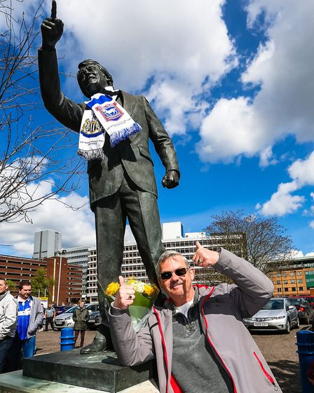 Newcastle fan Rob Atkinson with the Sir Bobby Robson statue in Portman Road. Picture: STEVE WALLER