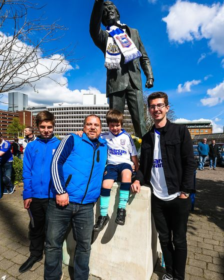From left: Ipswich fans Archie, Neil, William and Ryan Norman, with the Sir Bobby Robson statue in P