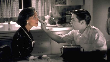Tobey Maguire's David applying make up to disguise the fact that his TV mother (Joan Allen) has gone