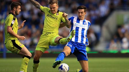 Rotherham United's Danny Ward (left) battles for possession of the ball with Brighton and Hove Albio