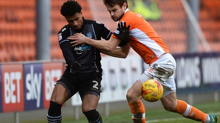 Richard Brindley, who scored his goal of the season for the U's at Morecambe, is seen here grappling
