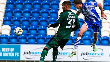 Chris Porter heads low with this chance in the first half of the U's League Two match against Plymou