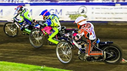 Rory Schlein and Josh Bates leading Ben Barker in heat nine at Foxhall on Saturday night. PHOTO: STE