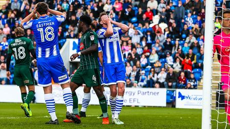 Chris Porter and Tom Eastman have their hands on their heads after a late free kick fails to yield a
