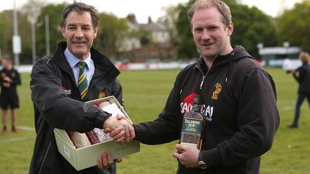 Mike Robinson makes a presentation to Head Coach, Gavin Hogg after his last game in charge at the Ha