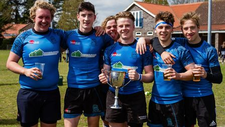 Captain Lewis Jacobs with the cup and some of his team-mates