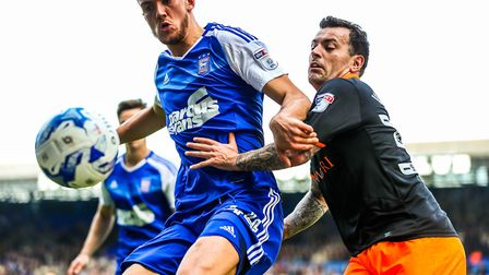 Emyr Huws and Ross Wallace battle during the first half of Ipswich Town's 1-0 ome defeat to Sheffiel