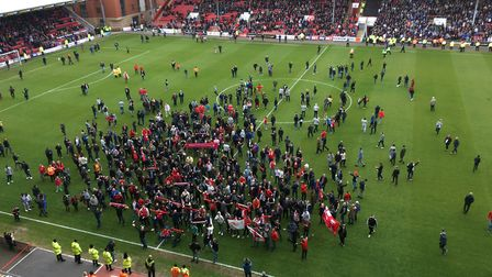 Leyton Orient fans on the pitch at Brisbane Road, protesting against owner Francesco Becchetti. Pict