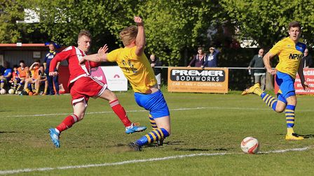 Tom Winter shoots past Mark Webster to double the score for Felixstowe