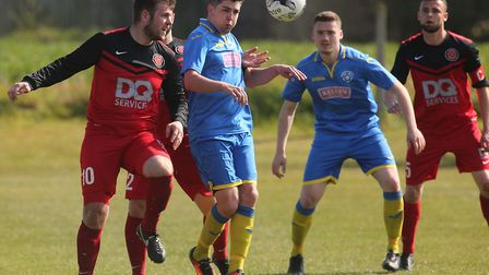 Ben Taylor and Ben Goodchild battle for the ball