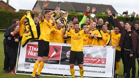 Mildenhall players celebrate their League Cup final victory. All photos: GREGG BROWN
