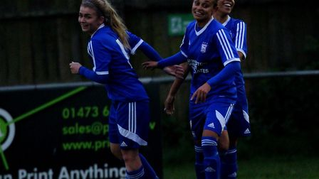 Sophie Welton celebrates with Roxanne Small and Jade Henry