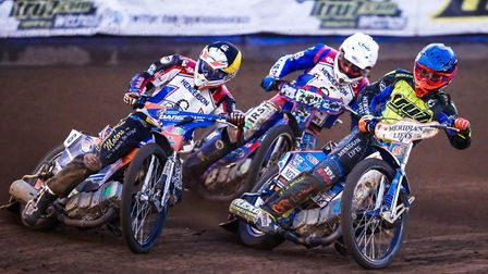 Kyle Newman inside Scorpions pair Stefan Nielsen (yellow helmet) and Josh Auty during an exciting h