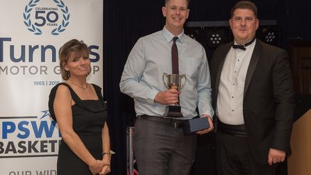 Colin Dockrell, centre, was named make club person of the year at the Ipswich Basketball Awards