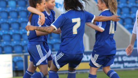 Amy Howlett celebrates her goal in the Suffolk Women's Cup Final with Hollie Clement, Natasha Thomas