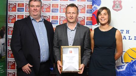 Shaun Peachment receives the FA Charter Standard Development Club of the Year award on behalf of Sto