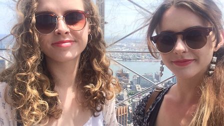 Rebecca Pizzey, right, with sister Eva on top of the Empire State Building in New York.Picture: REBE