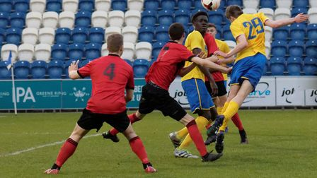 Sam Mills (No.29) rises to head home AFC Sudbury�s third goal in their Midweek Cup win. Picture: PAU