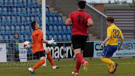 Ollie Dunlop (No.32) scores AFC Sudbury�s second goal in the Suffolk Midweek Cup win. Picture: PAUL