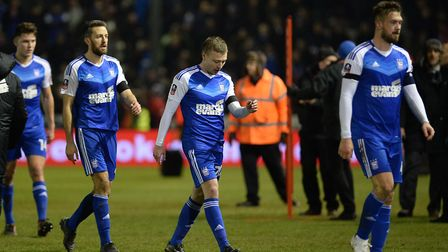 Ipswich Town's players leave the field following FA Cup defeat at Lincoln. Photo: PAGEPIX