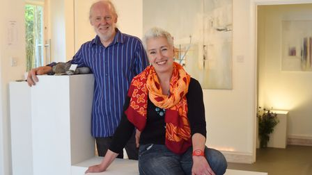 Ephemeral Gallery owner Ruth Purchase and sculptor Stephen Hicklin with some of Ruth Finn's painting