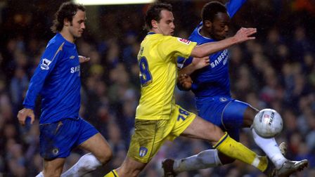 Ricardo Carvalho, left, looks on as Richard Garcia challenges Chelsea's Michael Essien during the FA