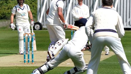Suffolk opener Michael Comber is caught behind by wicketkeeper Matt Taylor, off the bowling of Kamra