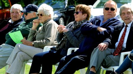 Spectators and officials enjoy the cricket as Woolpit hosted its first-ever Minor Counties fixture,