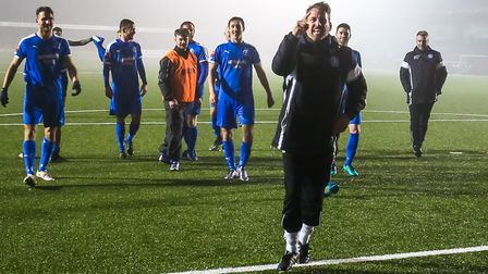 Leiston manager Glenn Driver shows his delight as he leaves the pitch after seeing his side defeat E
