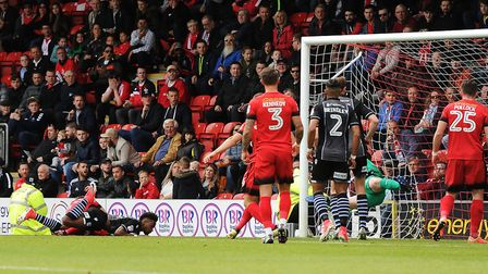 Tarique Fosu heads home the opening goal to put the U's 1-0 up at Leyton Orient this afternoon. Pict