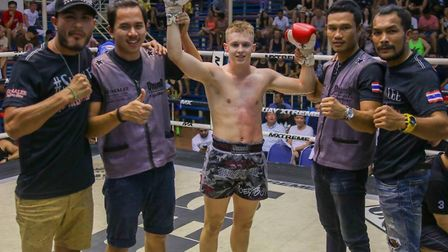 Joe Le Maire celebrates his latest victory in Thailand with the Sumalee Boxing Gym team. Picture: MR