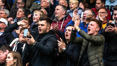U's fans cheer on their team to victory, while some of them keep an eye on the other scores via thei