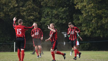 Joe Revell is congratulated after scoring his penalty