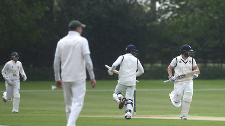 Copdock batsmen Jaik Mickleburgh and Martyn Cull cross for more runs during their opening stand of 7