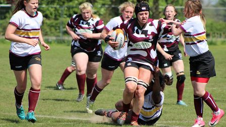 Harwich Owls' Mimi Montgomerie makes a determined run for Eastern Counties.