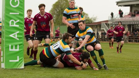 Diss Rugby Club's Steve Hipwell powers over the line to score a try,