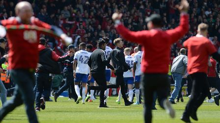 Ipswich Town players leave the field as Nottingham Forest fans invade the pitch following yesterday'